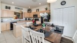 Breakfast nook with dining table & 6 chairs from Magna Bay 1 Villa for rent in Orlando