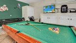 Games room with 2 strollers, childs car seat and booster seat with this Orlando Villa for rent direct from owner
