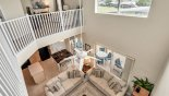 Upstairs landing with views over family room - www.iwantavilla.com is the best in Orlando vacation Villa rentals