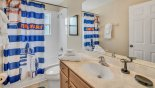 Villa rentals in Orlando, check out the Family bathroom #3 with bath & shower over, built-in vanity unit & WC