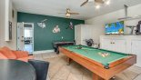 Games room with pool table, air hockey, smart TV and portable AC - www.iwantavilla.com is your first choice of Villa rentals in Orlando direct with owner