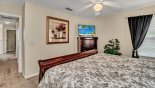 Spacious rental Emerald Island Resort Villa in Orlando complete with stunning Master bedroom #2 with 42