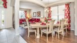 Dining area and living room beyond with this Orlando Villa for rent direct from owner