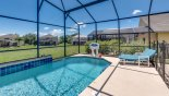 Villa rentals in Orlando, check out the Pool with waterfall feature and poolside basketball game
