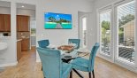 Villa rentals in Orlando, check out the Dining area with seating for 4 persons viewed towards kitchen