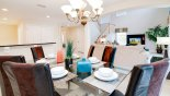 Spacious rental Providence Villa in Orlando complete with stunning Dining area viewed towards family room