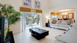 Casa Marina 1 Villa rental near Disney with Family room viewed towards dining area through arched opening