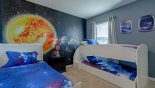 Space themed bedroom #5 with twin bed & bunk beds (sleeps 3 kids) with this Orlando Villa for rent direct from owner