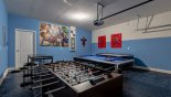 Marvel themed games room with pool table, air hockey & table foosball - www.iwantavilla.com is your first choice of Villa rentals in Orlando direct with owner