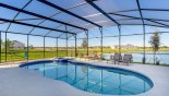 Extended deck with 30' pool & spa enjoying stunning lake views with this Orlando Villa for rent direct from owner