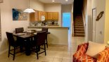 Breakfast nook adjacent to kitchen with seating for 4 with this Orlando Villa for rent direct from owner
