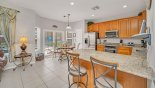 Kitchen & breakfast nook - patio door access onto pool deck with this Orlando Villa for rent direct from owner
