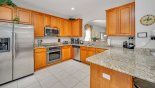 Villa rentals in Orlando, check out the Fully fitted kitchen with quality stainless steel appliances & granite counter tops