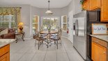 Villa rentals near Disney direct with owner, check out the Kitchen viewed towards breakfast nook and pool deck beyond