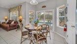Breakfast nook with 3 way views onto pool deck - www.iwantavilla.com is the best in Orlando vacation Villa rentals