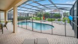 View from covered lanai towards pool showing pool safety fence erected from Brentwood 11 Villa for rent in Orlando