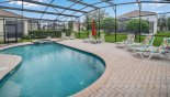 View of extended pool deck - South facing for all-day sun with this Orlando Villa for rent direct from owner