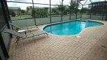 Pool & spa showing 2 out of the 4 sun loungers provided with this Orlando Villa for rent direct from owner