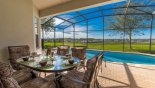 Alfreco breakfast in the private covered lanai is a must do !! with this Orlando Villa for rent direct from owner