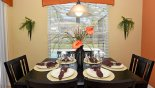 Dining area with seating for 6 and views onto pool deck from Windsor Hills Resort rental Villa direct from owner