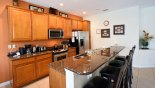 State of the art kitchen with granite countertops with this Orlando Villa for rent direct from owner