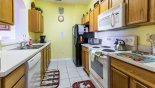 Fully fitted kitchen off entrance hallway with this Orlando Condo for rent direct from owner
