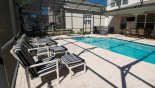 Villa rentals in Orlando, check out the Pool area showing 4 sun loungers