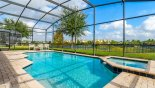 Villa rentals near Disney direct with owner, check out the Large pool & spa with views over lake towards resort facilities beyond