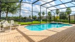 Large pool deck with 2 sun loungers - www.iwantavilla.com is the best in Orlando vacation Villa rentals