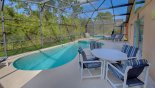 Spacious rental Emerald Island Resort Villa in Orlando complete with stunning Pool deck with patio table & 4 chairs