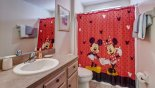 Family bathroom 3 with Mickey theming situated between bedrooms 4 & 5 from Emerald Island Resort rental Villa direct from owner