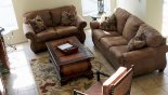 Family room with plenty of comfortable seating - www.iwantavilla.com is your first choice of Villa rentals in Orlando direct with owner