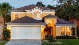 View of villa from street at twilight - www.iwantavilla.com is the best in Orlando vacation Villa rentals