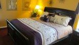 Master Bedroom 3 with queen bed, ensuite bathroom & TV - www.iwantavilla.com is the best in Orlando vacation Villa rentals