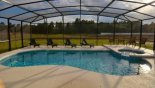 View of pool & spa with 4 sun loungers from Watersong Resort rental Villa direct from owner