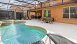 Pool deck with 5 sun loungers plus 2 patio tables with total of 10 chairs - www.iwantavilla.com is the best in Orlando vacation Villa rentals