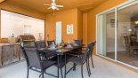 Spacious rental Watersong Resort Villa in Orlando complete with stunning Patio table under lanai with 6 chairs